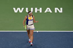 WUHAN, Sept. 28,  2017 Jelena Ostapenko of Latvia celebrates during the singles quarterfinal match against Garbine Muguruza of Spain at 2017 WTA Wuhan Open in Wuhan, capital of central China's Hubei Province, on Sept. 28, 2017. (Credit Image: © Ou Dongqu/Xinhua via ZUMA Wire)