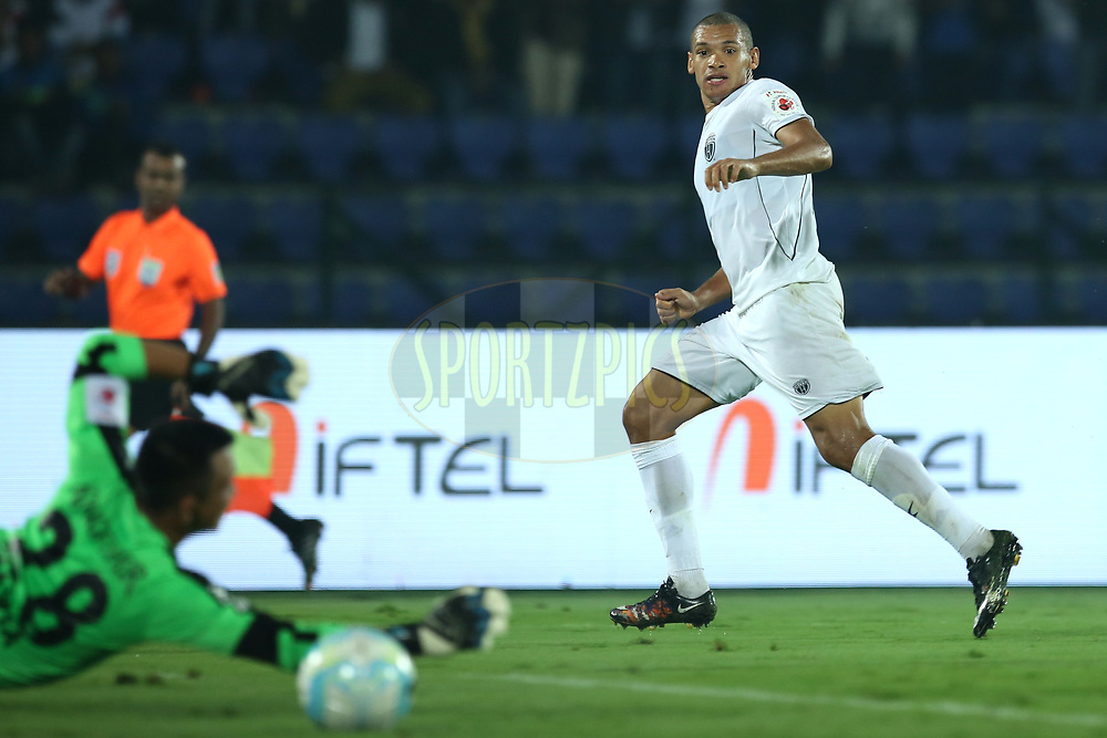Danilo LOPES CEZARIO of Northeast United FC hit the shot during match 19 of the Hero Indian Super League between NorthEast United FC and Bengaluru FC held at the Indira Gandhi Athletic Stadium, Guwahati India on the 8th December 2017<br /> <br /> Photo by: Deepak Malik  / ISL / SPORTZPICS