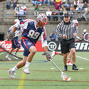 Paul Rabil #99 of the Boston Cannons runs to the ball during the game at Harvard Stadium on April 27, 2014 in Boston, Massachusetts. (Photo by Elan Kawesch)