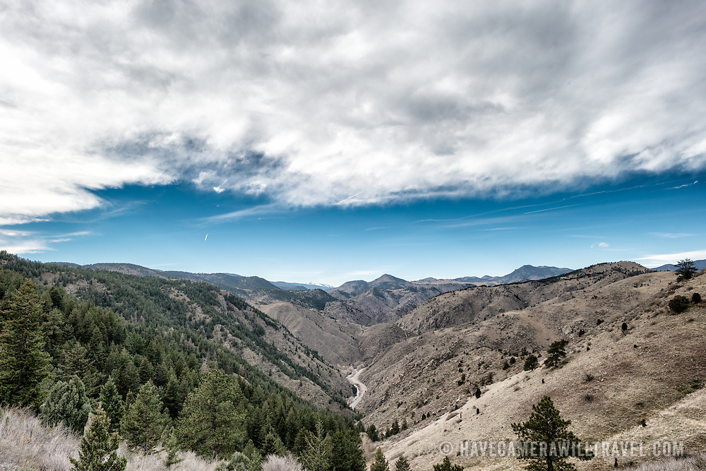 A view of Clear Creek Canyon from Lookout Mountain near Golden, Colorado. Clear Creek and the Clear Creek Canyon Road running alongside it can be seen in the lower center of frame, with the Colorado Rockies in the distance.