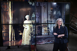 © Licensed to London News Pictures. This image is free to use ONLY in connection with the launch of the 'WOMEN: New Portraits' exhibition. 13/1/2016. London, UK. UBS and Annie Leibovitz launch 'WOMEN:New Portraits' at Wapping Hydraulic Power Station. Here Annie stands with an earlier portrait of Queen Elizabeth II. The exhibition opens to the public from Saturday 16th January until 7th February 2016. The newly commissioned photographs by the world renowned photographer will travel to 10 cities over the course of twelve months – London, Tokyo, San Francisco, Singapore, Hong Kong, Mexico City, Istanbul, Frankfurt, New York and Zurich. Access will be free to the public. Photo credit: Peter Macdiarmid/LNP