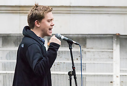 London, November 28th 2015. As Prime Minister David Cameron pushes for Parliament to vote to allow aerial strikes against Islamic State targets in Syria, Britain's Stop The War Coalition and thousands of anti-war protesters demonstrate outside Downing Street. PICTURED: Journalist and author Owen Jones addresses the crowd.  //// FOR LICENCING CONTACT: paul@pauldaveycreative.co.uk TEL:+44 (0) 7966 016 296 or +44 (0) 20 8969 6875. ©2015 Paul R Davey. All rights reserved.