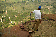 The world's toughest golf hole where players have to tee off from a MOUNTAIN onto the green 400 yards below (and have to be flown there by helicopter)<br /> <br /> Forget your local pitch and putt, this mammoth Par 3 is one of golf's greatest challenges - and that's just getting to the tee!<br /> The Extreme 19th is the world's longest par 3, measuring 391 yards, and challengers can only access the tee by helicopter.<br /> Sat atop South Africa's Hanglip Mountain, at 400 metres tall it is also the globe's highest hole, meaning it takes almost 30 seconds for any tee shot to reach the Africa-shaped green below.<br /> Part of the Legend Golf Resort, situated in South Africa's Waterberg mountain range, the course has been designed by 18 of the globes top players, including Justin Rose and Retief Goosen.<br /> Irishman Padraig Harrington, the 2008 Open Champion, was the first person to make par on the hole but has since been joined by Morgan Freeman and many more.<br /> As there are no cameras or GPS used to track the flight of the golf ball, a spotter is employed to try and locate where it lands.<br /> ©Exclusivepix