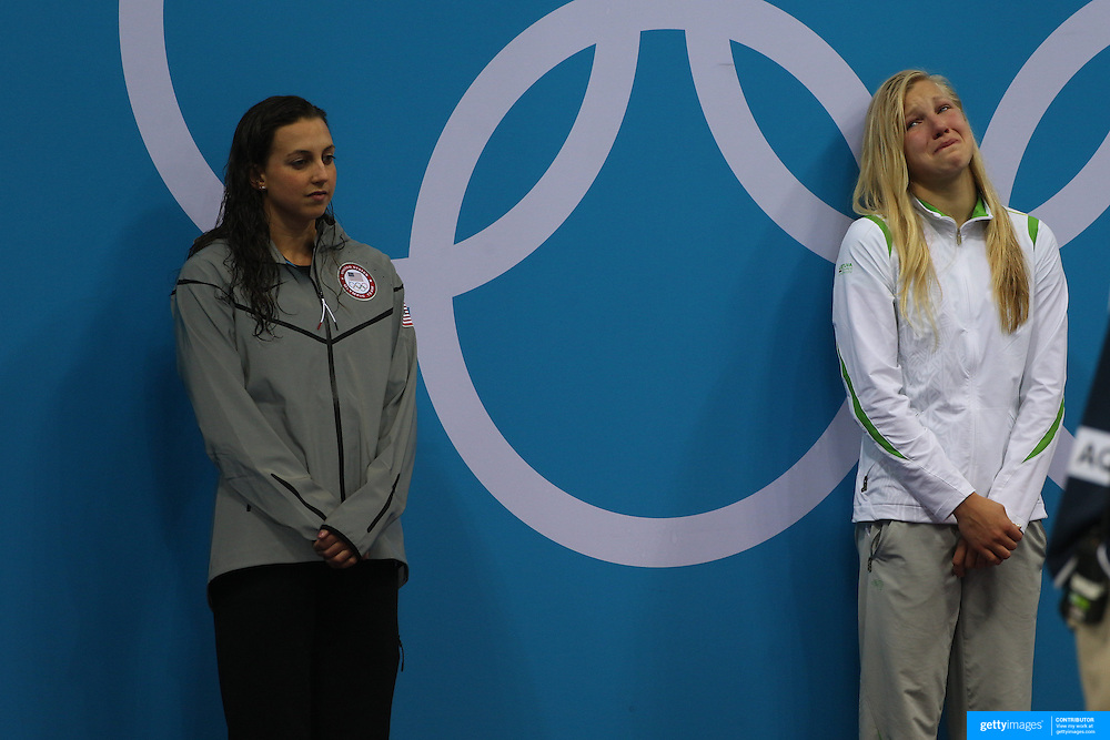 Fifteen year old Ruta Meilutyte, Lithuania, in tears on the podium after winning the gold medal in the Women's 100m Breaststroke Final, Rebecca Soni, USA, (left) won the silver medal at the Aquatic Centre at Olympic Park, Stratford during the London 2012 Olympic games. London, UK. 30th July 2012. Photo Tim Clayton