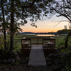 A viewing platform next to the Essex River salt marsh at the Cox Reservation in Essex, Massachusetts.