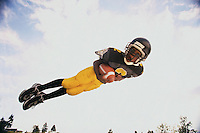 Boy Diving to Catch Football --- Image by © Jim Cummins/CORBIS