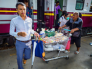 31 MAY 2017 - CHACHOENGSAO, THAILAND: Passengers get off a Bangkok bound train while a food vendor works at the train station in Chachoengsao, a provincial town about 50 miles and about an hour by train from Bangkok. The train from Chachoengsao to Bangkok takes a little over an hour but traffic on the roads is so bad that the same drive can take two to three hours. Thousands of Thais live outside of Bangkok and commute into the city for work on trains, busses and boats.       PHOTO BY JACK KURTZ