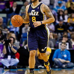 December 17, 2010; New Orleans, LA, USA; Utah Jazz point guard Deron Williams (8) against the New Orleans Hornets during the first half at the New Orleans Arena.  The Hornets defeated the Jazz 100-71. Mandatory Credit: Derick E. Hingle