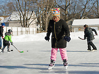 Carmella Pagliarulo takes it slow as she dons ice skates during Laconia Parks and Recreation skating party at Memorial Park on Friday afternoon.  (Karen Bobotas/for the Laconia Daily Sun)