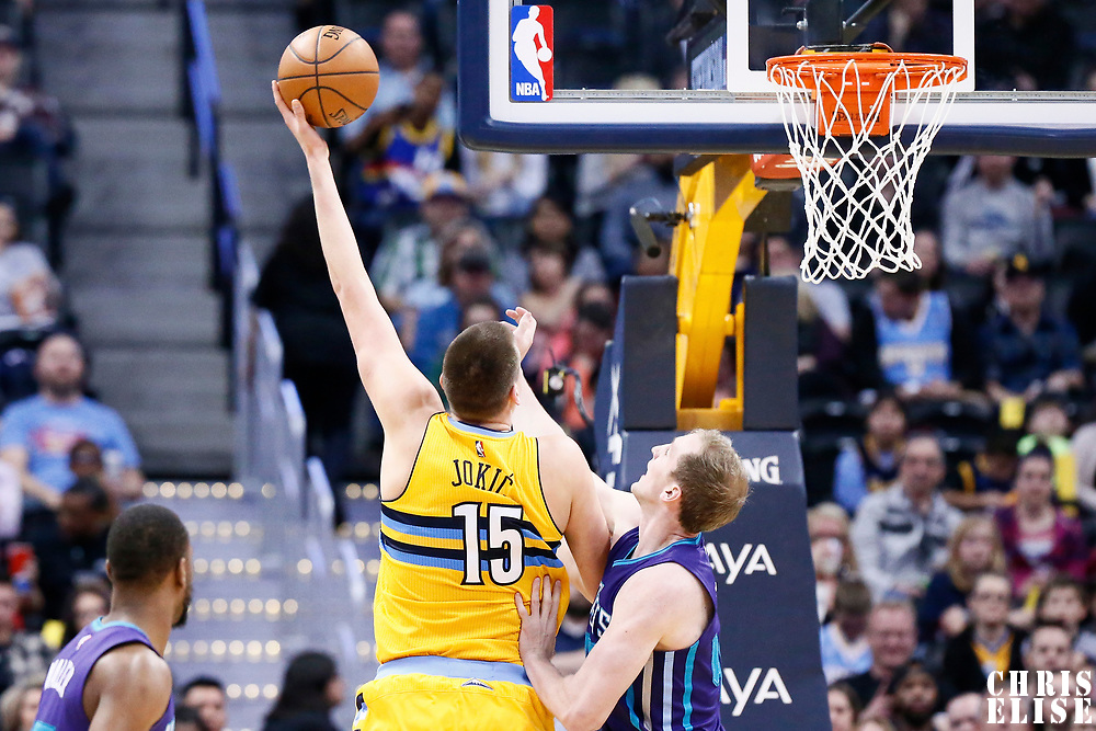 04 March 2017: Denver Nuggets forward Nikola Jokic (15) goes for the baby hook over Charlotte Hornets center Cody Zeller (40) during the Charlotte Hornets 112-102 victory over the Denver Nuggets, at the Pepsi Center, Denver, Colorado, USA.