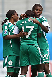 25.07.2010,  Augsburg, GER, FIFA U20 Womens Worldcup, , Viertelfinale, USA vs Nigeria,  im Bild  Freude nach dem 1-1 durch Helen UKAONU (Nigeria #17) mit Rebecca KALU (Nigeria #10) und Osinachi OHALE (Nigeria #20)  , EXPA Pictures © 2010, PhotoCredit: EXPA/ nph/ . Straubmeier+++++ ATTENTION - OUT OF GER +++++ / SPORTIDA PHOTO AGENCY
