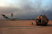 A U.S. Army 3rd Division Bradley fighting vehicle stands guard on the tarmac at the Baghdad International Airport following an allied advance April 4, 2003 on the Iraqi capital. U.S. and Iraqi forces exchanged heavy fire throughout the day as they battled for control of the strategic facility.