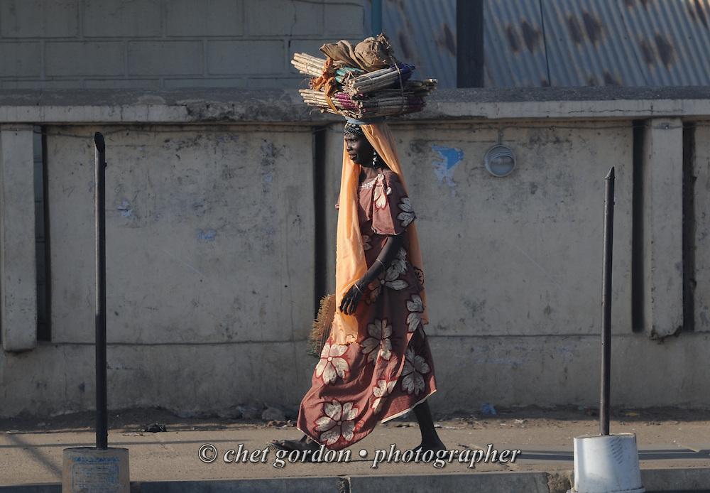 A Nigerian woman walks along Kofar Mata Road in Kano, Nigeria on Wednesday, December 5, 2012.