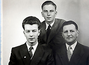 studio portrait of father with sons 1950s