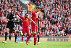 LIVERPOOL, ENGLAND - Saturday, October 5, 2013: Liverpool's captain Steven Gerrard celebrates scoring the third goal against Crystal Palace from the penalty spot during the Premiership match at Anfield. (Pic by David Rawcliffe/Propaganda)