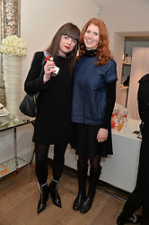 Left to right, KOO DONNELLY and LARA HUGHES YOUNG at a Valentine's charity event to raise heart awareness and support the charity Arrhythmia Alliance held at Sophie Gass, 4 Ladbroke Grove, London on 13th February 2014.