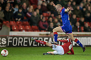 Curtis Main (on loan from Doncaster Rovers) (Oldham Atheltic) jumps the challenge of Conor Hourihane (Barnsley) during the Sky Bet League 1 match between Barnsley and Oldham Athletic at Oakwell, Barnsley, England on 12 April 2016. Photo by Mark P Doherty.