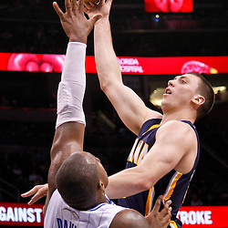 March 11, 2012; Orlando, FL, USA; Indiana Pacers power forward Tyler Hansbrough (50) shoots over Orlando Magic power forward Glen Davis (11) during the fourth quarter of a game at  Amway Center. The Magic defeated the Pacers 107-94.  Mandatory Credit: Derick E. Hingle-US PRESSWIRE