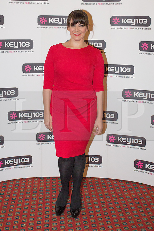 © Licensed to London News Pictures . 08/11/2013 . Manchester , UK . JODIE PRENGER . Stars in front of the Key 103 brand board at Manchester Town Hall ahead of performing on stage . The Christmas lights are turned on in Manchester this evening (Friday 8th November 2013) . Photo credit : Joel Goodman/LNP