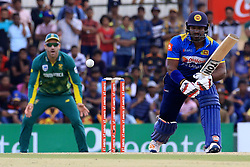 July 28, 2018 - Dambulla, Sri Lanka - Sri Lankan cricketer Kusal Perera plays a shot watched by South African cricket captain Faf Du Plessis during the 1st One Day International cricket match between Sri Lanka and South Africa at Rangiri Dambulla International Stadium, Dambulla, Sri Lanka on Sunday 29 July 2018  (Credit Image: © Tharaka Basnayaka/NurPhoto via ZUMA Press)