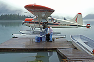 Off-loading 5 days of supplies at a Wannigan in Simpson Bay, off Prince William Sound, near Cordova, Alaska.   Wannigan is an Alaskan name for a floating cabin/camp on pontoons. This one is anchored over 60 feet of tidal water. Only access is by plane or boat.  The Beaver Float Plane is a legend in Bush Pilot lore.