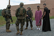 Marine Corps Base Quantico..Marine officers, role-playing the arrest of insurgents..The Basic School at Camp Barrett  is where all incoming Marine officers are trained. Seven companies of about 300 officers come through every year..Bravo company, shown here, undergoes training before sent out to lead Marine units.