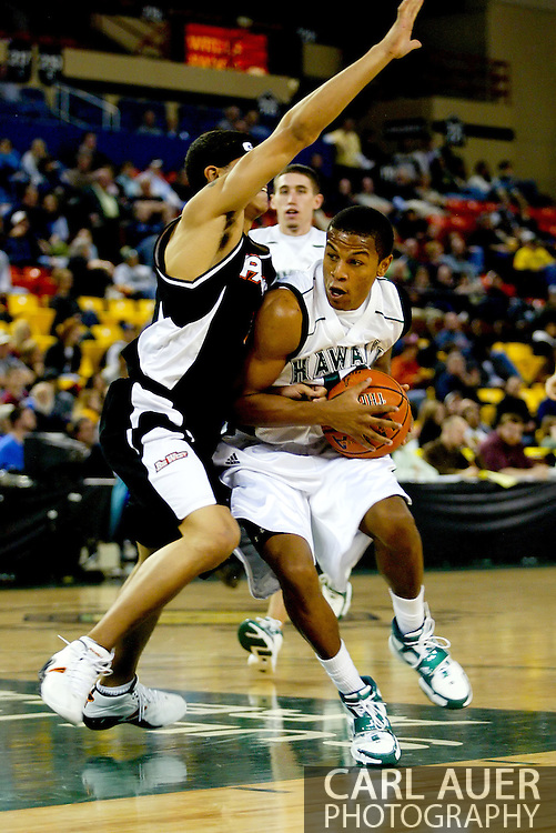11/25/2006 - Anchorage, Alaska: Sophomore guard Dominic Waters (11) of the Hawaii Warriors cuts around the defense as he attacks the hoop to help Hawaii beat Pacific 71-60 to give the Warriors a third place finish in the 2006 Great Alaska Shootout<br />
