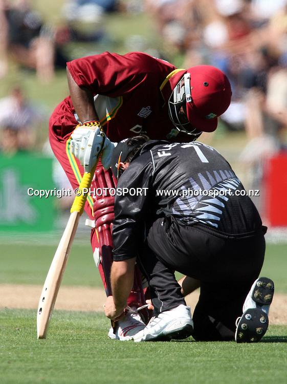 Stephen Fleming ties the laces of Runako Morton during the fourth ODI cricket match between the Black Caps and West Indies at Mclean Park, Napier, New Zealand, on Wednesday 1 March 2006. Photo: John Cowpland/PHOTOSPORT