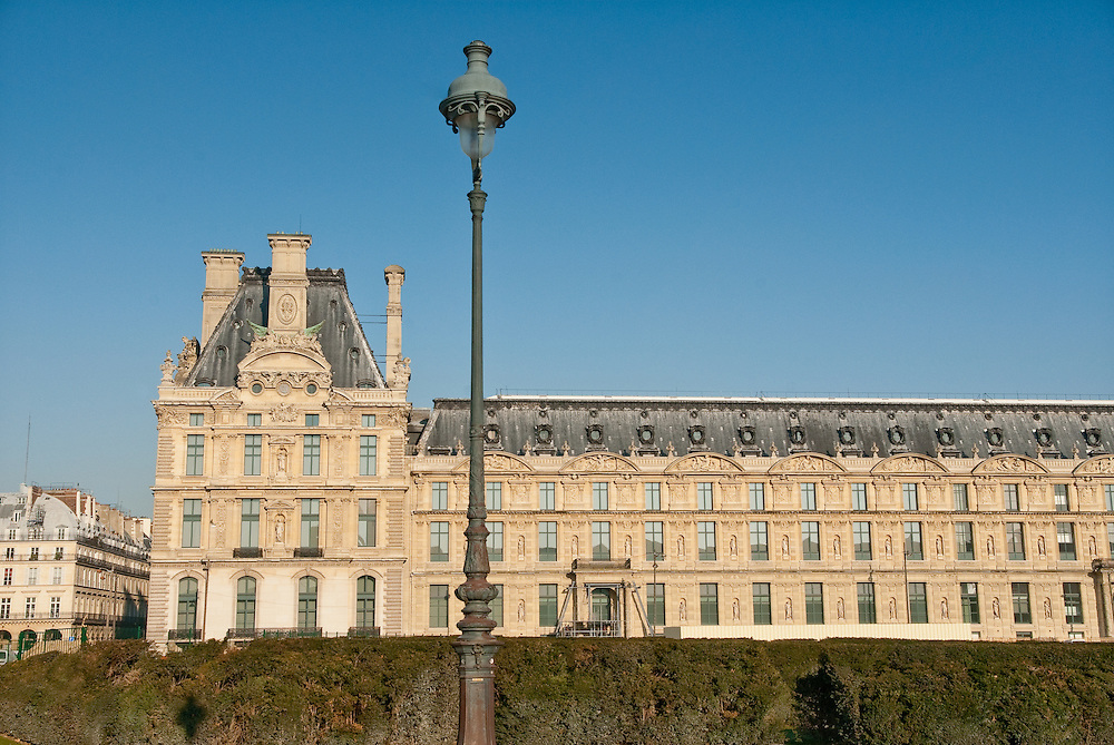 Exterior of Louvre museum, Paris with street lamp.