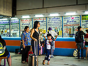 04 JANUARY 2015 - BANGKOK, THAILAND: Passengers walk through the Ekkamai Bus Station in central Bangkok. Buses from Ekkamai go to Chonburi, Rayong, and Trat provinces, including the resort city of Pattaya. Millions of Thais hit the road Sunday returning to Bangkok after the long weekend New Year holiday. Train stations and trains were packed and the state owned bus company scheduled thousands of extra buses to handle the demand.    PHOTO BY JACK KURTZ