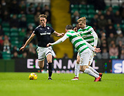 4th April 2018, Celtic Park, Glasgow, Scotland; Scottish Premier League football, Celtic versus Dundee; Mark O'Hara of Dundee takes on Stuart Armstrong and Callum McGregor of Celtic