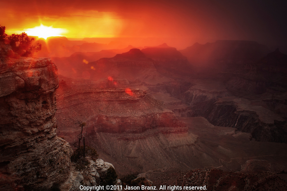 Monsoon season sunset and storm over the Grand Canyon, Arizona.