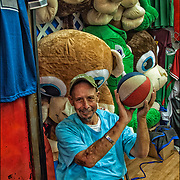 Boardwalk amusement arcade barker stuffed prize animals. <br /> <br /> Basket Ball at the Arcades shooters try to making baskets for prizes.