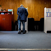 A voter casts his ballot at a polling station in Barrio Logan.