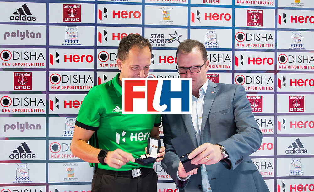BHUBANESWAR - The Odisha Men's Hockey World League Final . Match ID 01 . Umpire Eduardo Lizana received the golden whistle  from FIH CEO , Jason McCracken.    WORLDSPORTPICS COPYRIGHT  KOEN SUYK