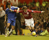 Photo: Aidan Ellis.<br /> Manchester United v Chelsea. The Barclays Premiership. 26/11/2006.<br /> United's Gabriel Heinze holds off Chelsea's Michael Ballack