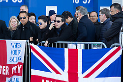 © Licensed to London News Pictures. 29/10/2018. Leicester, UK. Tributes outside the King Power Stadium, home of Leicester City FC following the fatal events on Saturday evening. Pictured, the owners son and family visit the tributes. Photo credit: Dave Warren/LNP