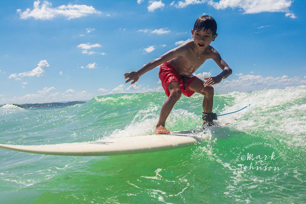 6 year old boy surfing at Coolangatta Beach, Gold Coast, Queensland, Australia