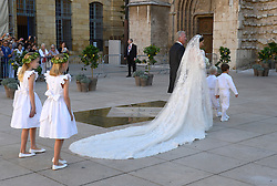 Wedding Of Prince Felix Of Luxembourg & Claire Lademacher, German student Claire Lademacher  accompanied by her father Hartmut, before the religious wedding ceremony with Prince Felix of Luxembourg during their wedding at the Saint Mary Magdalene Basilica in Saint-Maximin-La-Sainte-Baume, southern France, September 21, 2013.  Picture by Schneider- Press / i-Images<br /> UK & USA ONLY