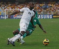 Photo: Steve Bond/Richard Lane Photography.<br />Ghana v Nigeria. Africa Cup of Nations. 03/02/2008. Quincy Owusu-Abeyie (L) is fouled by Taiwo Taye (R)