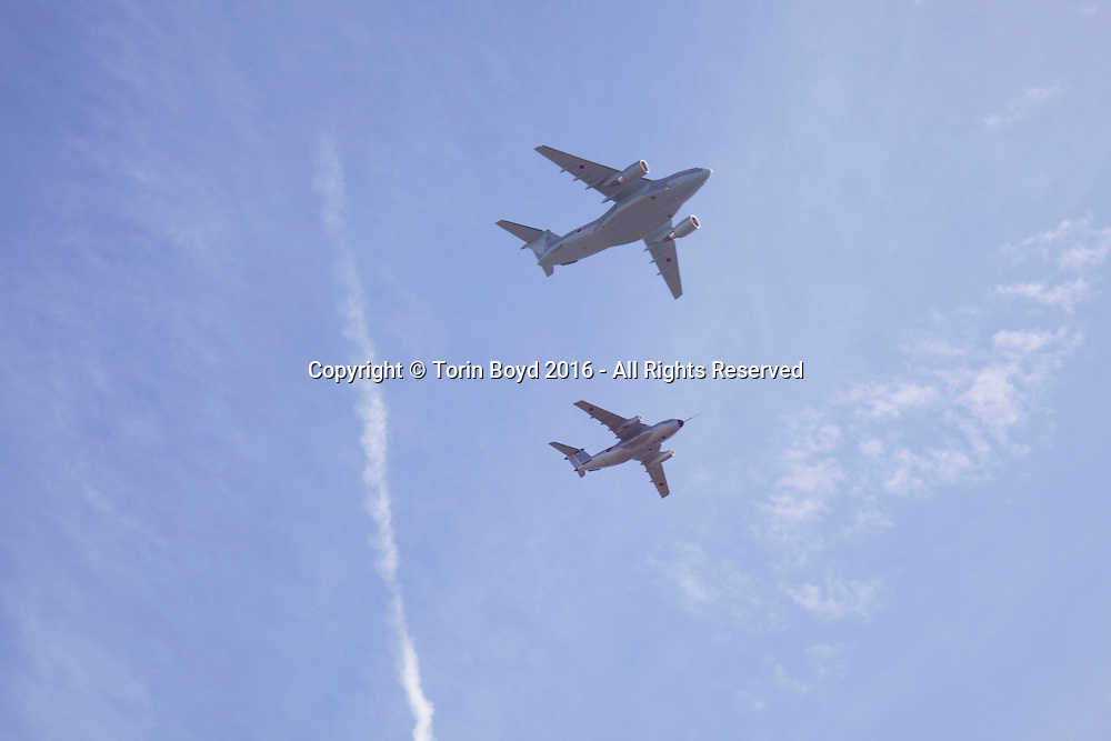 October, 23, 2016, Asaka, Saitama Prefecture, Japan: An overhead display by the Japan Air Self Defense Force of jets, prop and cargo planes was held during an annual military review held at the Asaka Training Area, a Japan Ground Self Defense Force (JSDF) military base on the outskirts of Tokyo. Blue Impulse is similar to America's Blue Angels and from 11 Squadron 4th Air Wing of the Japan Air Self Defense Force based at Matsushima Air Base. For this event, Prime Minister Shinzo Abe, top ranking Japanese brass and international dignitaries were in attendance to view Japan's military might. This included 4000 troops, 27 divisions, 280 vehicles and artillery, plus 50 aircraft of the Ground, Air, and Maritime branches of the JSDF. (Torin Boyd/Polaris).