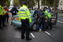 © Licensed to London News Pictures. 07/10/2019. London, UK. Extiction Rebellion protestors gather on Victoria Embankment. Activists will converge on Westminster blockading roads in the area for at least two weeks calling on government departments to 'Tell the Truth' about what they are doing to tackle the Emergency. Photo credit: Rob Pinney/LNP