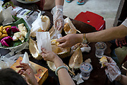 A group of tourists from Hong Kong feast on a Musang King durian on their annual trip to Malaysia to eat durians at Durian Kaki, a roadside fruit stall owned by Tan Eow Chong and his family in Bayan Lepas, Pulau Pinang, Malaysia on Sunday, June 16th, 2019. Tan Eow Chong is an award-winning durian farmer famed for his Musang King variety, and last year exported 1000 tons of the fruit to China from his family-run durian empire, expanding from an 80 acre farm to 1000 acres.  Photo by Suzanne Lee/PANOS for Los Angeles Times