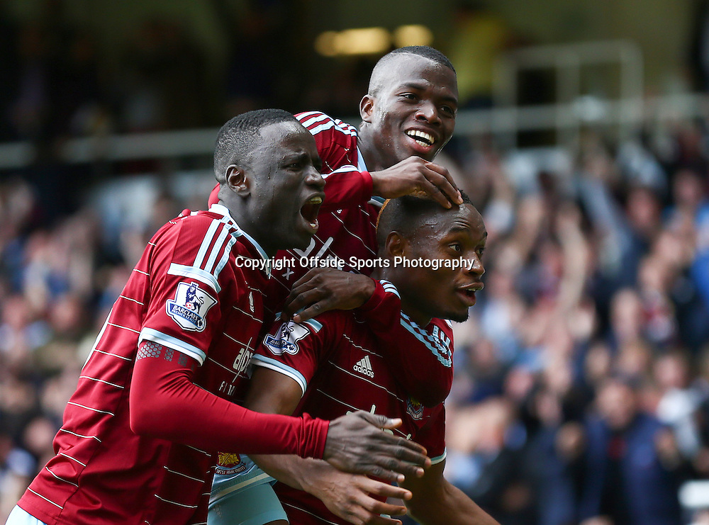 25 October 2014 - Barclays Premier League - West Ham v Manchester City - Diafra Sakho of West Ham (R) celebrates scoring the winning goal with team mates - Photo: Marc Atkins / Offside.