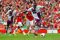 Aston Villa's Christian Benteke takes a penalty  - Photo mandatory by-line: Mitch Gunn/JMP - Tel: Mobile: 07966 386802 17/08/2013 - SPORT - FOOTBALL - Emirates Stadium - London -  Arsenal V Aston Villa - Barclays Premier League