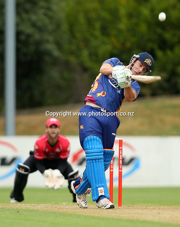 Hamish Rutherford launches into a drive but skies the ball to be dismissed.<br /> Twenty20 Cricket - HRV Cup, Otago Volts v Canterbury Wizards, 13 January 2012, University Oval, Dunedin, New Zealand.<br /> Photo: Rob Jefferies/PHOTOSPORT