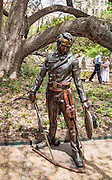 """""""Colonel Travis - the Line"""" statue by James Nathan Muir, on loan at the Alamo in 2014, San Antonio, Texas, USA. """"To each of us comes a time for the courage to take a stand - to draw 'The Line'."""" The Alamo Mission in San Antonio (or """"The Alamo"""") was originally known as Mission San Antonio de Valero, a former Roman Catholic mission and fortress compound, and the site of the Battle of the Alamo in 1836. It is now a museum in the Alamo Plaza District of Downtown San Antonio, Texas, USA."""
