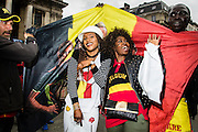 June 18 2016 Brussels Belgium. Fans of the Red Devils, the Belgian national soccerteam celebrate the victory of the tream at the European championship in France. they celebrate in the center of Brussels, at the pedestrian zone in front of the Beurs where few months ago the terrorist attacks wre remembered.two girls being surprised by guys with flag