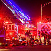 Gallup firefighters extinguish a house fire on Maloney Avenue and Third Street in Gallup Monday.