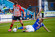 Carlisle United Defender Danny Grainger making a superb tackle on Exeter City Midfielder Lee Holmes during the Sky Bet League 2 match between Carlisle United and Exeter City at Brunton Park, Carlisle, England on 17 October 2015. Photo by Craig McAllister.